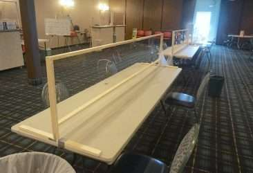 view of covid-19 safety plexiglass barrier at bingo wed night kc in north kc